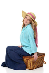 blonde woman sitting on picnic basket