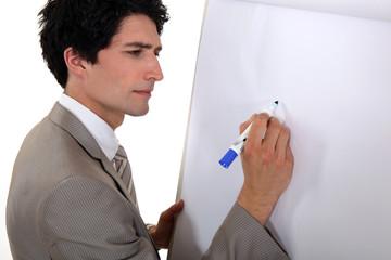 Man drawing on flip chart