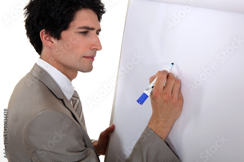 Man drawing on flip chart