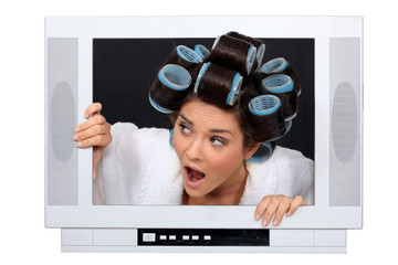 Woman escaping from television set