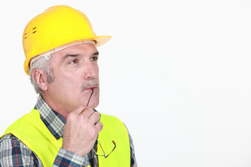 Pensive construction worker
