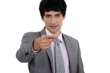 Businessman pointing his finger