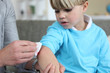 Little boy with grazed elbow