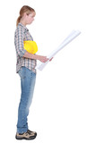 Female construction worker stood reading plans