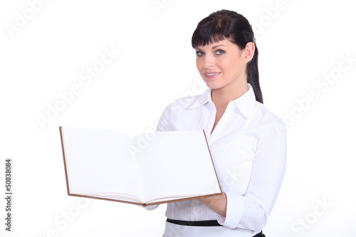 a waitress presenting a visitors book