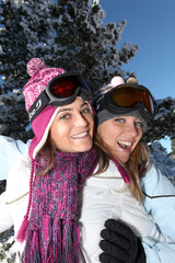 Two female friends in the snow