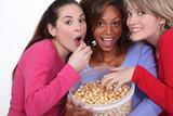 Friends eating caramel popcorn together