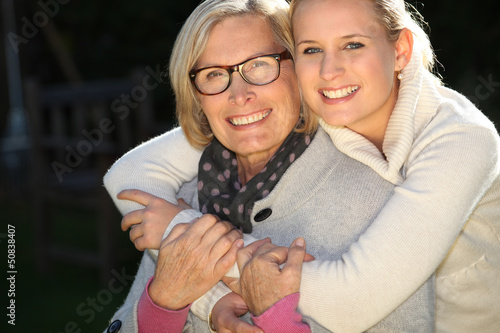 Girl embracing her grandmother
