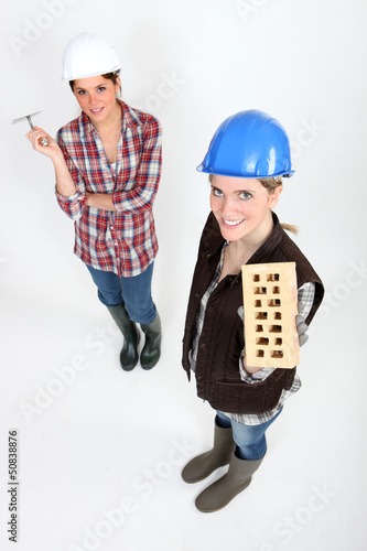 Women with trowel and brick