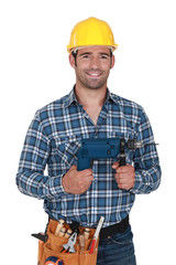 Builder with a power drill