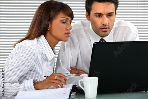 Young business couple hard at work