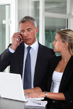 Boss working closely with female colleague