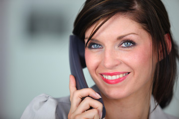 Friendly brunette receptionist