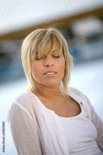 Woman outdoors with her eyes closed