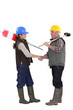 Construction workers shaking hands