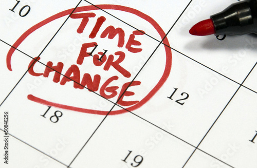time for change sign written with pen on calendar