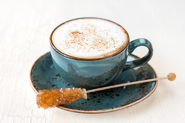 cup of latte or cappuccino and caramel sugar