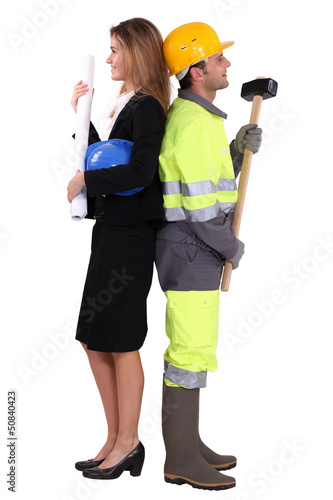 businesswoman and craftsman standing back to back