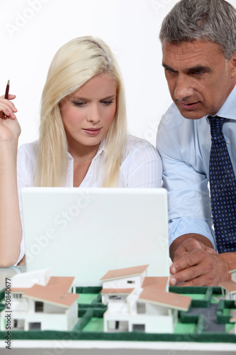 real estate businessman and his secretary working