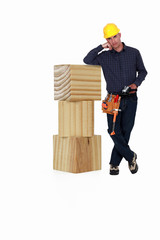 Builder with wooden blocks