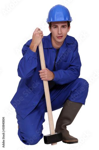 Labourer holding a mallet