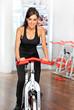 canvas print picture - Junge Frau auf Spinningrad