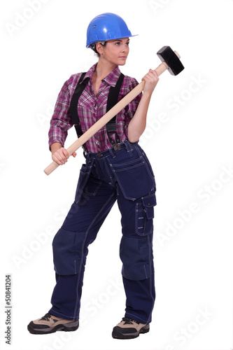 Female construction worker holding a rubber mallet