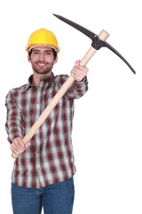 Tradesman holding up a pickaxe
