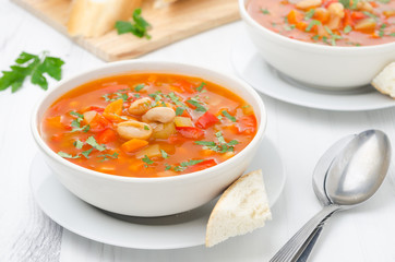 Vegetable soup with white beans in a bowl