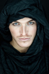 beautiful man with black scarf