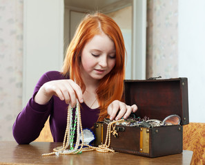 teen girl chooses jewelry
