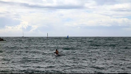 man in canoe ocean