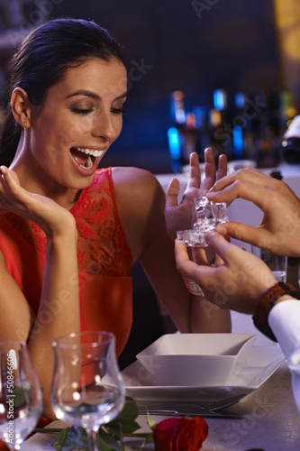 Happy woman getting engagement ring