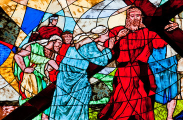 Stained glass showing Jesus carrying the cross