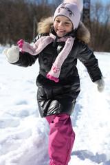Beautiful little girl in winter park