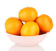Tasty mandarines in color bowl isolated on white