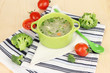 Diet soup with vegetables in pan on wooden table close-up