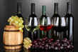 Assortment of wine in glasses and bottles on grey background