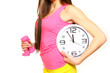 Athletic young woman with a clock and dumbbells
