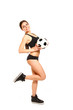 Athletic girl posing with a soccer ball on a white background
