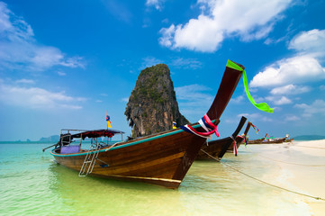 Tropical beach landscape. Thai traditional long tail boats