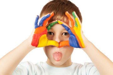 funny kid is hamming with coloured hand