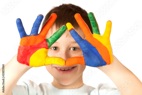 happy boy with stained coloured hand