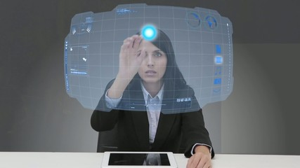 Businesswoman selecting futuristic interface