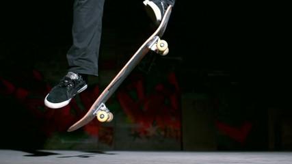 Skater doing ollie trick on concrete