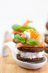 caviar canape with smoked salmon, cream cheese and basil
