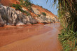Red river between rocks and jungle, Mui Ne, Vietnam