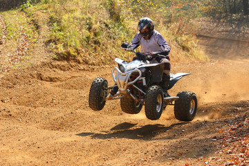 Quad motorbike rider jumps