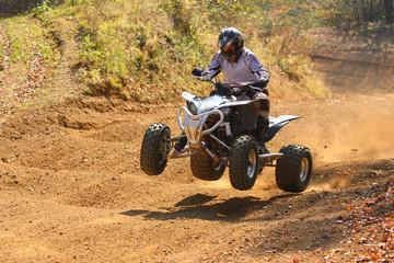 Quad motorbike rider jumps