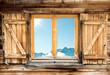 Leinwandbild Motiv weathered mountain hut window shutter
